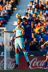 Sergio Busquets Burgos (l) of FC Barcelona battles for the ball with Claudio Beauvue of CD Leganes during the La Liga 2017-18 match between CD Leganes vs FC Barcelona at Estadio Municipal Butarque on November 18 2017 in Leganes, Spain. Photo by Diego Gonzalez / Power Sport Images