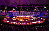 "27 JUL 2012 - LONDON, GBR - NHS staff and volunteers perform a jive during the ""Second To The Right, And Straight On Till Morning"" section of the Opening Ceremony of the London 2012 Olympic Games in the Olympic Stadium in the Olympic Park, Stratford, London, Great Britain (PHOTO (C) 2012 NIGEL FARROW)"