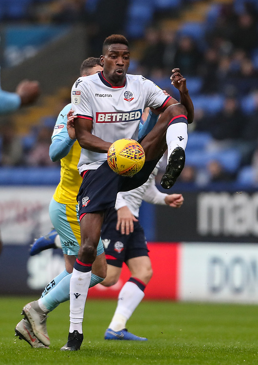 Bolton Wanderers' Sammy Ameobi under pressure from Rotherham United's Anthony Forde<br /> <br /> Photographer Andrew Kearns/CameraSport<br /> <br /> The EFL Sky Bet Championship - Bolton Wanderers v Rotherham United - Wednesday 26th December 2018 - University of Bolton Stadium - Bolton<br /> <br /> World Copyright © 2018 CameraSport. All rights reserved. 43 Linden Ave. Countesthorpe. Leicester. England. LE8 5PG - Tel: +44 (0) 116 277 4147 - admin@camerasport.com - www.camerasport.com