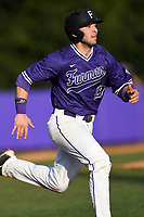 Third baseman Jake Crawford (19) of the Furman Paladins runs out a batted ball in game two of a doubleheader against the Harvard Crimson on Friday, March 16, 2018, at Latham Baseball Stadium on the Furman University campus in Greenville, South Carolina. Furman won, 7-6. (Tom Priddy/Four Seam Images)