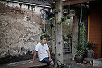 """KADEEJEEN, BANGKOK, THAILAND, DECEMBER 2012:..Local Houses in Kadeejeen where people works and lives, this kind of houses are called """" shop House """", Dec 2012..The Kadeejeen neighbourhood comprises six communities  Wat Kalaya, Kudeejeen, Wat Prayurawong, Wat Bupparaam, Kudee Khao and Roang Kraam...Ever since the Thonburi era (in the 17th Century), these historic neighbourhoods have maintained the diverse cultural heritage of three religions and four beliefs (Theravada Buddhism, Mahayana Buddhism, Christianity and Muslim) while coexisting in peaceful harmony...The neighbourhood is still characterised by Bangkok's traditional urbanism which is that of a fine-grained, religious establishment-centred urban structure with close-knit social cohesion. ©Giulio Di Sturco/Reportage by Getty Images."""