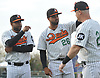 Newly signed Long Island Ducks pitcher Francisco Rodriguez #57, left, and Carlos Pimentel #26, center, greet teammate Lew Ford #20 during pregame introductions that preceded the team's season home opener against the Southern Maryland Blue Crabs at Bethpage Ballpark in Central Islip, NY on Friday, May 4, 2018.