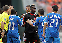 WASHINGTON, D.C. - AUGUST 19, 2012:  Nick DeLeon (18) and Brandon McDonald (4) of DC United argue with Danny Cruz (44) and Freddy Adu (11) of the Philadelphia Union during an MLS match at RFK Stadium, in Washington DC, on August 19. The game ended in a 1-1 tie.