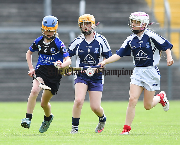 Seren Clancy of Kilkee/Kilbaha in action against Caoimhe Hayes and Rachel Guerin of Bridgetown during their Schools Division 6 final at Cusack Park. Photograph by John Kelly