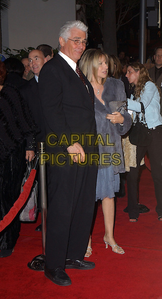 "JAMES BROLIN & BARBARA STREISAND.Universal Pictures' Premiere of ""Meet The Fockers"" held at Universal City Walk in Universal City, California  December 16th, 2004.full length, celebrity couple, black suit.www.capitalpictures.com.sales@capitalpictures.com.Supplied By Capital PIctures"
