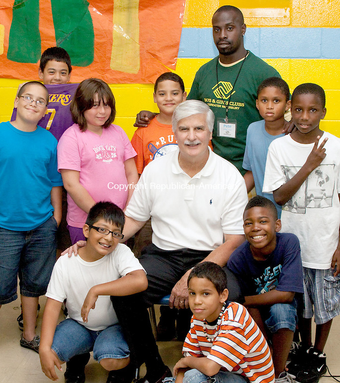 WATERBURY CT-AUGUST 22 2011 -082212DA05- John Chiero, center, is the new executive director of the Boys & Girls Club in Waterbury. Chiero is surrounded by members of the club in Waterbbury on Wednesday..Darlene Douty Republican-American