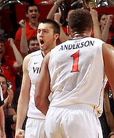 Virginia forward/center Mike Tobey (10) reacts to a play next to Virginia guard Justin Anderson (1) during the first half of an NCAA basketball game against Louisville Saturday Feb. 7, 2015, in Charlottesville, Va. (Photo/Andrew Shurtleff)