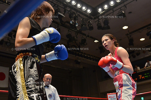 (L-R)  Kai Johnson Tomomi Takano (JPN),<br /> JUNE 24, 2014 - Boxing :<br /> Kai Johnson of Japan and Tomomi Takano of Japan during the second round of the 6R super flyweight bout at Korakuen Hall in Tokyo, Japan. (Photo by Hiroaki Yamaguchi/AFLO)