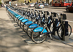 Racks of bikes available for rental under Barclays bicycle hire scheme, London