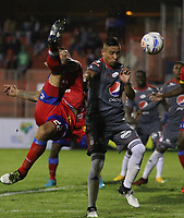 PASTO - COLOMBIA - 24 - 03 - 2018: Gaston Cellerino (Izq.) jugador de Deportivo Pasto disputa el bal—n con Carlos Lizarazo (Der.) jugador de America de Cali, durante partido Deportivo Pasto y America de Cali, de la fecha 10 por la Liga Aguila I 2018, jugado en el estadio Departamental Libertad de la ciudad de Pasto.  / Gaston Cellerino (L) player of Deportivo Pasto fights for the ball with Carlos Lizarazo (R) player of America de Cali, during a match Deportivo Pasto and America de Cali, of the 10th date for the Liga Aguila I 2018 at the Departamental Libertad stadium in Pasto city. Photo: VizzorImage. / Leonardo Castro / Cont.