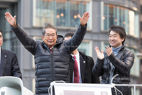 December 9, 2012, Tokyo, Japan - Former Tokyo Gov. Shintaro Ishihara, left, waves to a crowd of voters as he delivers his message in a rally in front of the Tokyo railroad station on Sunday, December 9, 2012, in his campaign for the December 16 general election. A recent poll showed the Japan Restoration Party founded by Osaka Mayor Toru Hashimoto, right, and led by Ishihara, who is running for a seat in the Diet lower chamber, followed close behind the most favored Liberal Democratic Party led by former Prime Minister Shinzo Abe. (Photo by AFLO)