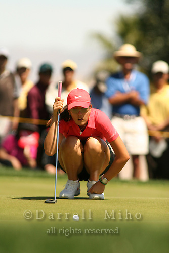 Apr. 2, 2006; Rancho Mirage, CA, USA; Michelle Wie lines up her putt during the final round of the Kraft Nabisco Championship at Mission Hills Country Club. ..Mandatory Photo Credit: Darrell Miho.Copyright © 2006 Darrell Miho .