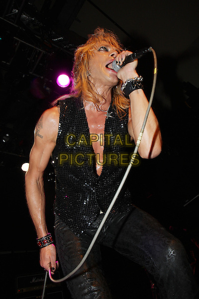 MICHAEL MONROE.Plays live in concert at the Islington Academy, London, England, UK, .April 9th 2010..music gig on stage half length  black sleeveless leather vest waistcoat trousers belt microphone sequined sequin sparkly mouth open star necklace  bracelet cuff singing sweaty .CAP/MAR.© Martin Harris/Capital Pictures.