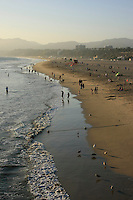 A view of people enjoying the late afternoon sun on the beach in  Santa Monica California .
