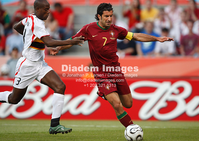 COLOGNE, GERMANY - JUNE 11:  Luis Figo of Portugal controls the ball during a FIFA World Cup soccer match against Angola June 11, 2006 in Cologne, Germany.  (Photograph by Jonathan P. Larsen)