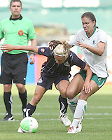 Lisa De Vanna #11 of the Washington Freedom is grabbed by Shannon Boxx #7 of St. Louis Athletica during a WPS match on May 1 2010, at RFK Stadium, in Washington D.C. Freedom won 3-1.
