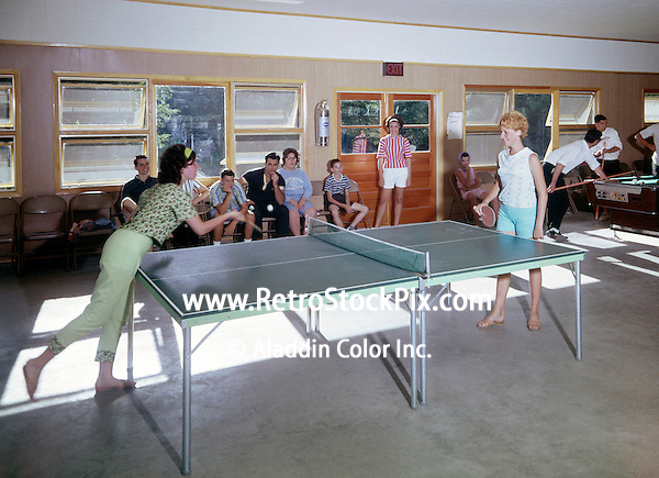 Breezy Knoll, Greenville, NY. Teenage girls playing ping pong in the game room.