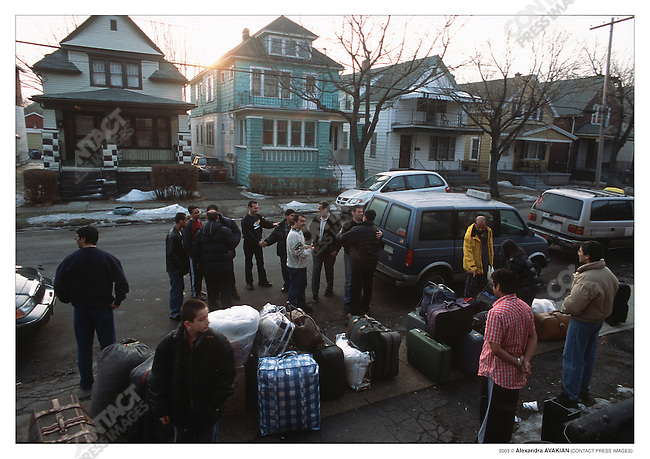 Pakistani packing up taxis to head for to the Canadian border at Vive La Casa, a refugee shelter, on the US side of the border; Buffalo, New York, March 2003.