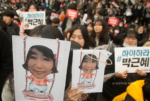 "South Korea Politics, Nov 5, 2016 : Middle and high school students attend a rally demanding South Korean President Park Geun-hye's resignation in Seoul, South Korea, a day after President Park said she will accept an investigation over a corruption scandal involving her confidante Choi Soon-sil. Tens of thousands of people marched in central Seoul after a rally as they demanded Park's resignation over a corruption scandal involving Choi who allegedly meddled in state affairs and pursued unlawful benefits for herself, local media reported. The Police said about 43,000 people gathered while organizers of the rally said about 150,000 people attended the rally. Signs (top L, bottom R) read,""Park Geun-hye resign"". Portraits which students are holding, depict Choi Soon-Sil meddling in state affairs. Park Geun-Hye is mocked by local protesters as the swings. (Photo by Lee Jae-Won/AFLO) (SOUTH KOREA)"