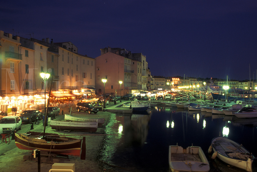 France, St. Tropez, Cote d' Azur, Provence, Var, Europe, View of the waterfront along the harbor of Saint Tropez in the evening on the Mediterranean Sea.