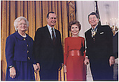 United States President George H.W. Bush presents the Medal of Freedom award to former U.S. President Ronald Reagan at a ceremony in the East Room of the White House on January 13, 1993.  Left to right: First Lady Barbara Bush; U.S. President George H.W. Bush; former First Lady Nancy Reagan; former U.S. President Ronald Reagan.<br /> Credit: White House via CNP