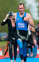 09 MAY 2010 - GRENDON, GBR - Sharkie Jaggard runs to transition after exiting the swim at the Grendon Triathlon .(PHOTO (C) NIGEL FARROW)