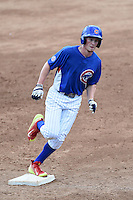 Bryce Denton (27) of Ravenwood High School in Brentwood, Tennessee playing for the Chicago Cubs scout team runs the bases after hitting a home run during the East Coast Pro Showcase on August 2, 2014 at NBT Bank Stadium in Syracuse, New York.  (Mike Janes/Four Seam Images)