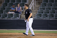 Kannapolis Intimidators manager Justin Jirschele (9) gets one last word in before leaving the field after having been ejected for arguing a call at first base in the bottom of the 9th inning during the game against the Hickory Crawdads at Kannapolis Intimidators Stadium on May 18, 2017 in Kannapolis, North Carolina.  The Crawdads defeated the Intimidators 6-4.  (Brian Westerholt/Four Seam Images)
