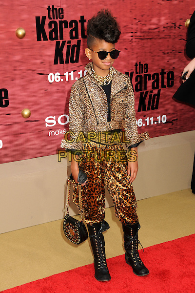 """WILLOW SMITH .""""The Karate Kid"""" Los Angeles Premiere held at Mann's Village Theatre, Westwood, California, USA,  .7th June 2010..full length harem trousers pants black boots lavce-up knee high bag hair quiff mohawk sunglasses gold chain necklace leopard animal brown print .CAP/ADM/BP.©Byron Purvis/AdMedia/Capital Pictures."""