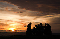 Silhouettes of Sri Lankas along the ramparts of Galle Old Fort - a popular spot to watch the sunset, cool off in the evening air and watch the world go by.