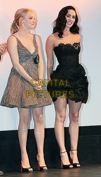 "AMANDA SEYFRIED & MEGAN FOX.""Jennifer's Body"" Premiere held at the Ryerson Theatre during the 35th Annual Toronto International Film Festival, Toronto, Ontario, Canada,.10th September 2009..full length grey gray strapless black dress on stage open toe ankle strap shoes Christian Louboutin ruffles lace .CAP/ADM/BPC.©Brent Perniac/Admedia/Capital Pictures"