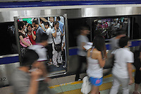 Passengers travel in the Beijing Subway, China. Beijing Subway is a rapid transit rail network that serves the urban and suburban districts of Beijing municipality. It is the oldest and busiest subway in mainland China, and the second longest after the Shanghai Metro..30 Aug 2010