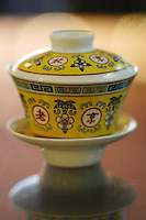 A traditional tea cup in Beijing, China, on August 20, 2004. Photo by Lucas Schifres/Pictobank