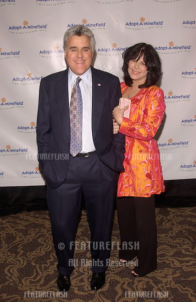 Comedian JAY LENO & wife MAVIS at the 4th Annual Adopt-A-Minefield Gala at the Century Plaza Hotel, Beverly Hills, California..October 15, 2004