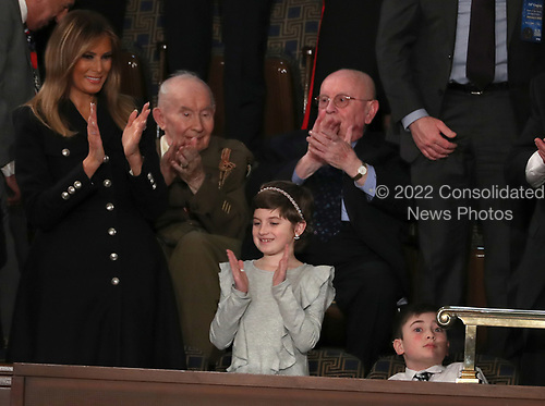 Grace Eline, who was diagnosed with Germinoma, a germ-cell brain tumor, applauds after being introduced by United States President Donald J. Trump during his second annual State of the Union Address to a joint session of the US Congress in the US Capitol in Washington, DC on Tuesday, February 5, 2019.  Grace recently finished chemotherapy and currently shows no evidence of the disease.  First lady Melania Trump applauds at left.  Joshua Trump, a sixth grader who was bullied at school because of his last name is pictured at right.<br /> Credit: Alex Edelman / CNP