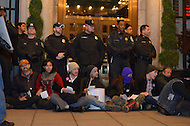 December 1, 2011  (Washington, DC)  DC Police are calm and unresponsive as protesters from OccupyDC block an entrance to the W Hotel in Washington, where the Democratic Congressional Campaign Committee (DCCC) held a fund raising dinner. The principle mission of the DCCC is to support Democratic House candidates.   (Photo by Don Baxter/Media Images International)