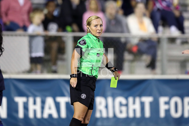 Cary, North Carolina  - Saturday September 09, 2017: Referee Karen Abt pulls out her yellow card during a regular season National Women's Soccer League (NWSL) match between the North Carolina Courage and the Houston Dash at Sahlen's Stadium at WakeMed Soccer Park. The Courage won the game 1-0.