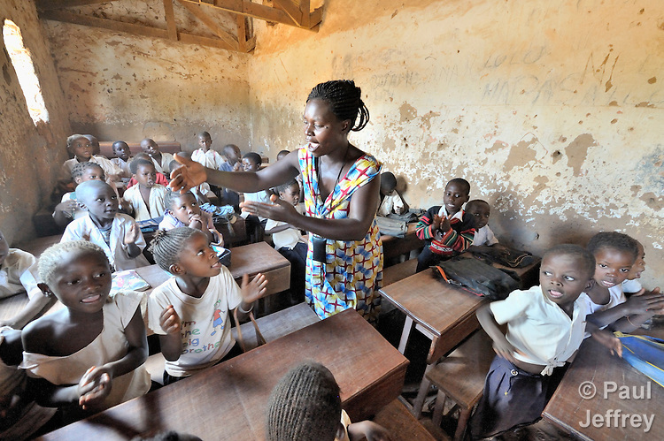 Claudethe Ilunga teaches in elementary school class in the Uweso II neighborhood of Lubumbashi, in the Democratic Republic of the Congo. Many students in the class receive school supplies, uniforms, scholarships and mentoring from the United Methodist Committee on Relief (UMCOR).