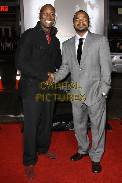 "TYRESE GIBSON & F. GARY GRAY.Premiere Screening Of Overture Films' ""Law Abiding Citizen"" held At The Grauman Chinese Theatre, Hollywood, California, USA..October 6th, 2009.full length black suit hand in pocket grey gray shaking hands .CAP/ADM/KB.©Kevan Brooks/AdMedia/Capital Pictures."
