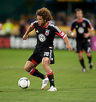 Nick DeLeon (18) of D.C. United carries the ball upfield at RFK Stadium in Washington DC.   Dallas FC fell to D.C. United, 4-1.