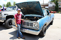 MEGAN DAVIS/MCDONALD COUNTY PRESS 17-year-old Paige Newhard stands by her first truck - a 1976 Dodge D100 Adventurer Sport - during the 2019 FORDification Auto Show. Despite owning a Dodge, the FORDification organizers have made her an honorary member. Newhard has invested hundreds of hours rebuilding the truck from the floor boards to the headliner.
