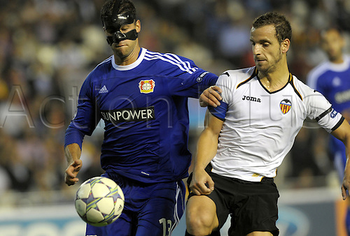 01.11.2011. Valencia, Spain.  Leverkusen's Michael Ballack (L) and Valencia's Roberto Soldado vie for the ball during the Champions League group E soccer match between Valencia CF and Bayer Leverkusen at the Estadi de Mestalla stadium in Valencia, Spain. Mandatory Credit: Actionplus