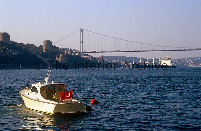 A small boat leaves the yali, speeding back down the Bosphorus towards Rumeli fortress in the distance
