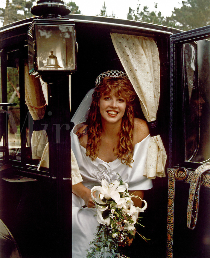Bride in a horse carriage - MODEL RELEASED.