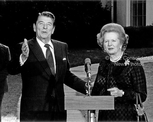 Washington, DC - (FILE) -- Prime Minister Margaret Thatcher of the United Kingdom, right, is shown with United States President Ronald Reagan following their meeting at the White House in Washington, D.C. on Wednesday, June 23, 1982.  Reagan is photographed as he admonished network reporter Sam Donaldson for asking a question during a photo opportunity, where a small pool of reporters is allowed to observe, but not question..Credit: Howard L. Sachs - CNP