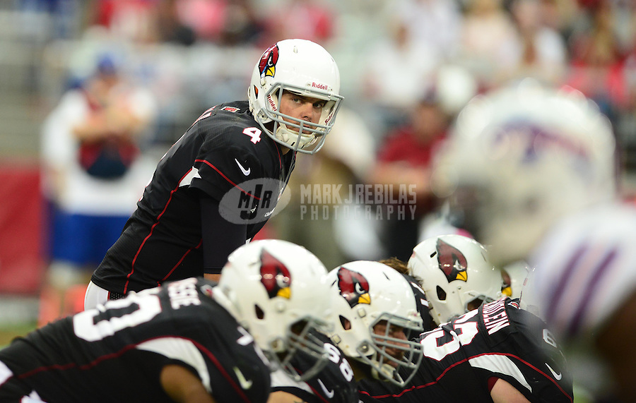 Oct. 14, 2012; Glendale, AZ, USA; Arizona Cardinals quarterback (4) Kevin Kolb prepares to take the snap against the Buffalo Bills at University of Phoenix Stadium. The Bills defeated the Cardinals 19-16 in overtime. Mandatory Credit: Mark J. Rebilas-