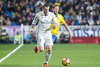 Garet Bale of Real Madrid competes for the ball with Dani Castellano of UD Las Palmas during the match of Spanish La Liga between Real Madrid and UD Las Palmas at  Santiago Bernabeu Stadium in Madrid, Spain. March 01, 2017. (ALTERPHOTOS / Rodrigo Jimenez) /NORTEPHOTOmex