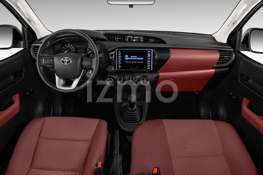 Stock photo of straight dashboard view of 2016 Toyota Hilux GL 4 Door Pickup Dashboard