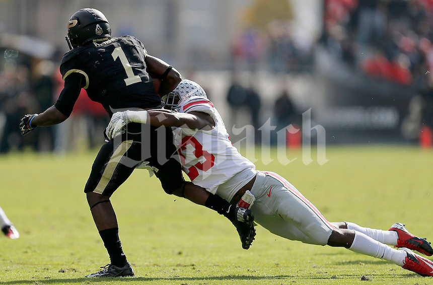 Ohio State Buckeyes defensive back Tyvis Powell (23) brings down Purdue Boilermakers running back Akeem Hunt (1) during the first half of the NCAA football game at Ross-Ade Stadium in West Lafayette, IN on Saturday, November 2, 2013. (Columbus Dispatch photo by Jonathan Quilter)