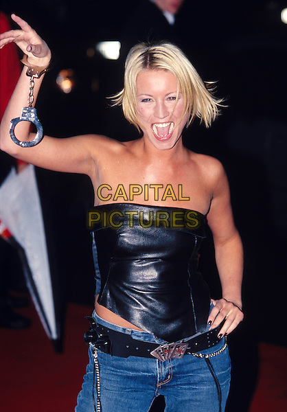 DENISE VAN OUTEN..Ref: 10709..short bleach blonde bob, strapless leather top, handcuffs, laughing, smiling, shoulders..www.capitalpictures.com..sales@capitalpictures.com..